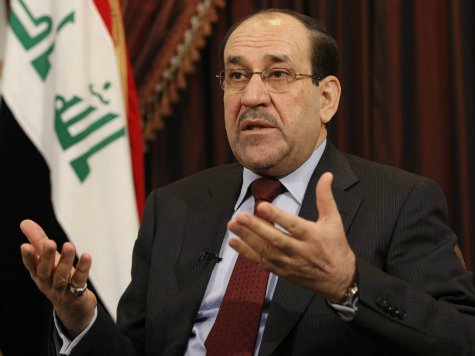 maliki-hands-up-reuters